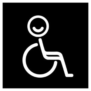 Novosan Inva-WC:n opastekyltti. Symbolikuvassa on pyörätuoli ja hymyilevä hahmo. Muoto: neliö. Väri: mustavalkoinen.