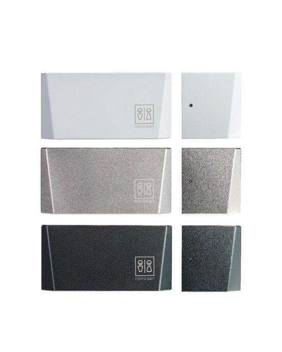 Novosan kuutio-käsienkuivaaja. Värivaihtoehdot: valkoinen, hopea ja grafiitinharmaa.