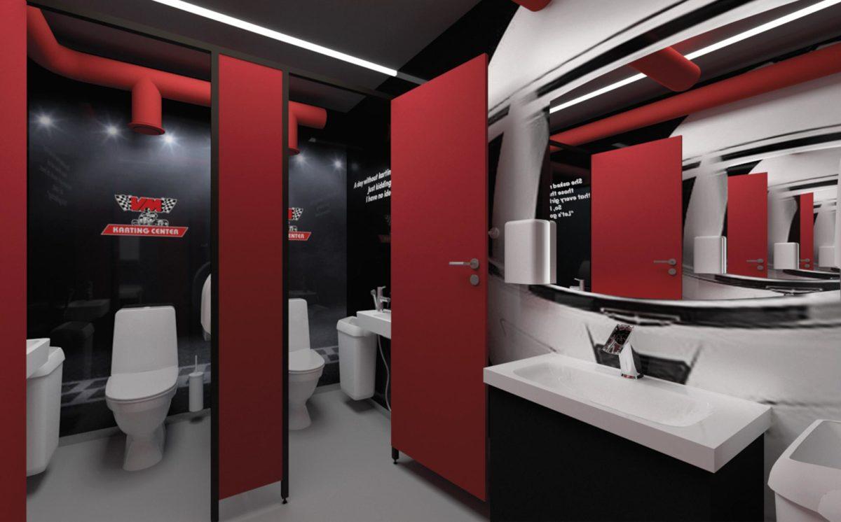 WC-tila on musta-valko-punaista ralliteemaa. WC-kopeissa on valkoiset WC-istuimet, altaat ja roska-astiat. Seinällä oleva peili esittää kypärää ja suojavisiiriä. Katossa on epäsuora valo.